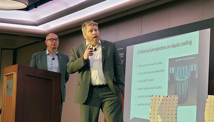 David Meadows (center) of STULZ USA discusses trends in liquid cooling at the recent DCD Enterprise NY conference. At left is Joerg Desler, President of Stulz Air Technology Systems USA. (Photo: Rich Miller)