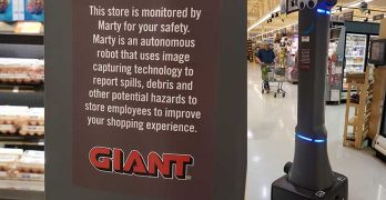 Marty (at right) is a robot that patrols the aisles of Giant Food Stores, using AI and computer vision to detect and report spills. (Photo: Rich Miller)