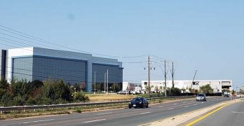 Two huge new data centers in Ashburn, Virginia, built by Digital Realty (left) and CloudHQ. (Photo: Rich Miller)