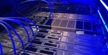 Servers immersed in dielectric fluid in a Submer SmartPodX immersion cooling enclosure. (Photot: Submer)