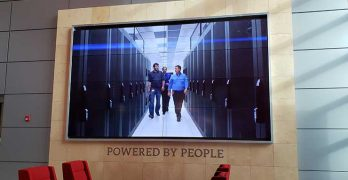 A video screen in the lobby of the QTS Data Centers facility in Ashburn, Va. (Photo: Rich Miller)