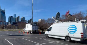 AT&T deploys a temporary cell tower in Nashville, with the company's iconic office tower visible at left. A Christmas Day explosion damaged the company's central office on Second Avenue, causing widespread network outages. (Image: AT&T)