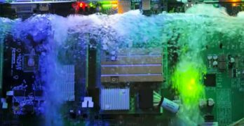 Bubbles rise from servers insider a tank of cooling liquid in the Microsoft lab., where the company is testing two-phase liquid cooling technology (Image: Microsoft)