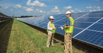 Workers inspect photovoltaic panels at a Dominion Energy solar generation facility in Virginia. (Photo: Dominion Energy)