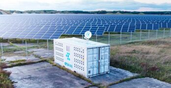 A cryptocurrency mining module next to a solar power array. (source: BusinessWire)