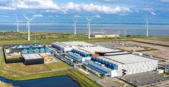 The Google data center campus at Eemshaven in the Netherlands, with nearby wind turbines in the background. (Photo: Google)