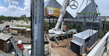 A Vapor IO edge computing module is lowered into place at a cell tower location in Atlanta. (Image: Vapor IO)