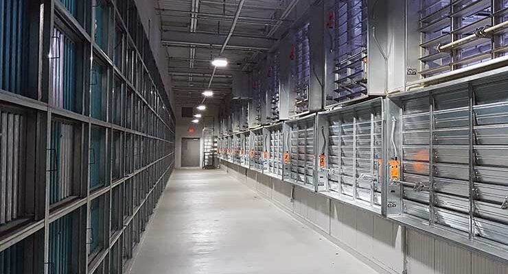 """The cooling """"penthouse"""" design of a Facebook data center in Prineville, Oregon. Servers are cooled with fresh air that enters through the louvers on the right, reducing the need for use of water and electricity. (Photo: Rich Miller)"""