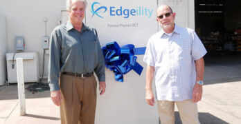 Forced Physics CEO and founder Scott Davis (left) with Phil McCoy, President of of Sun West Engineering and the new Edgeility module for edge computing. (Photo: Forced Physics)